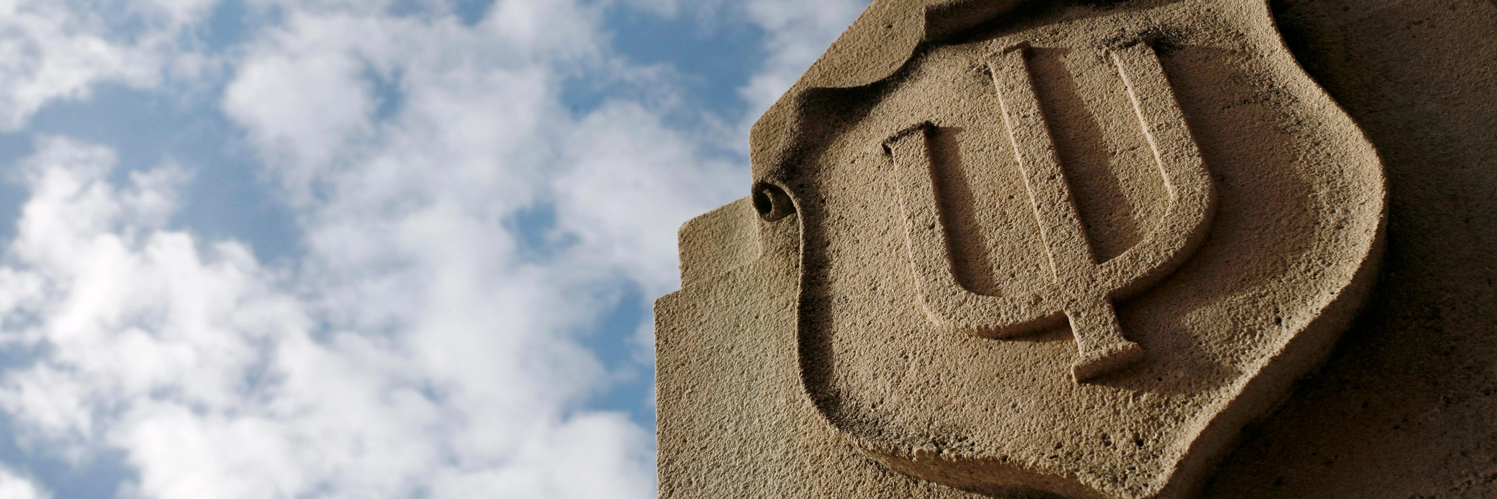 IU trident carved in limestone