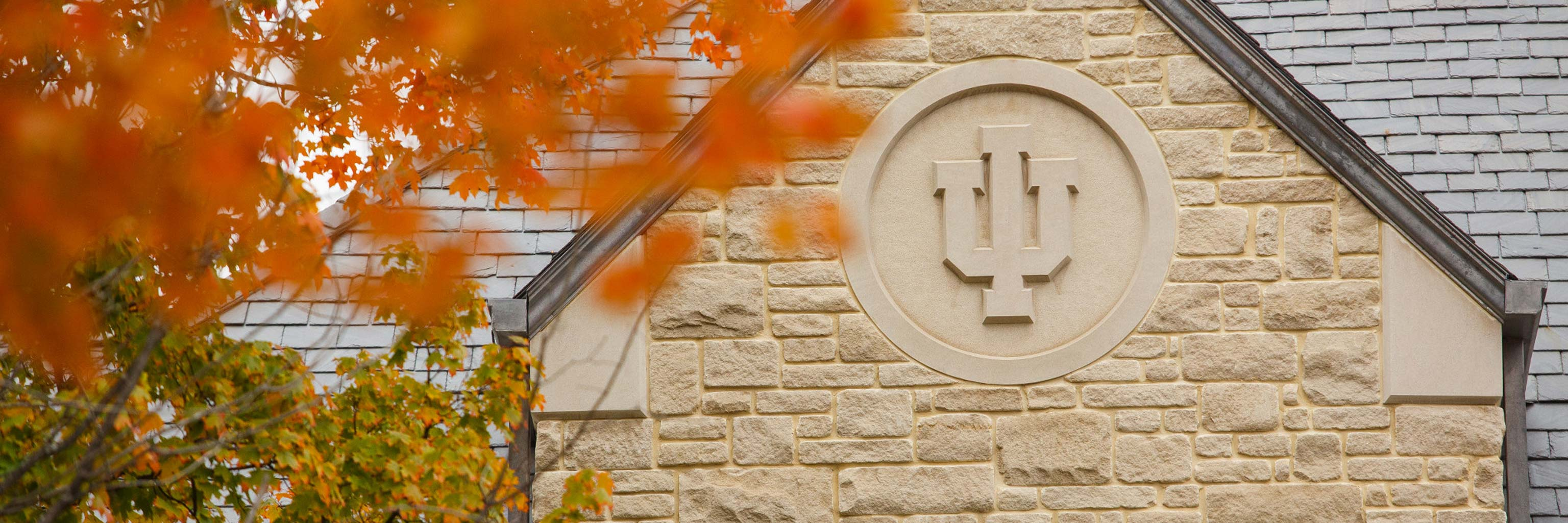 IU trident carved into the side of a limestone building