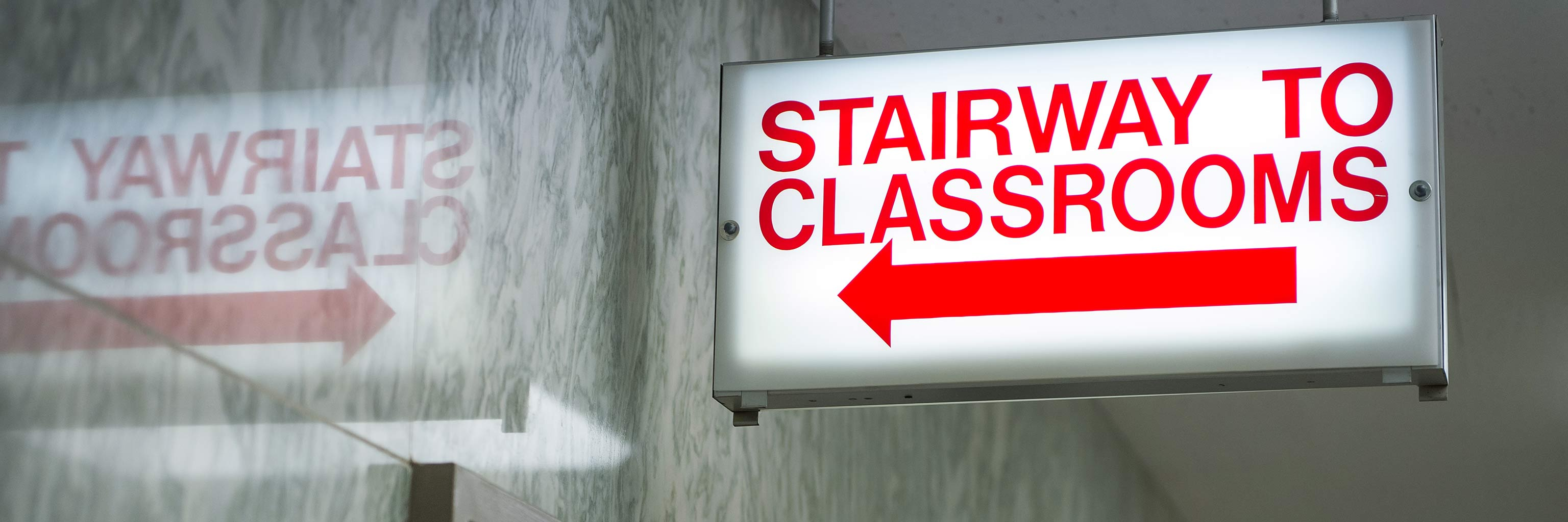 light up sign that says stairway to classrooms
