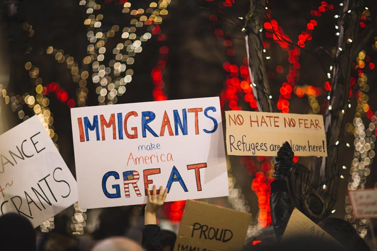 Homemade protest signs supporting immigrants